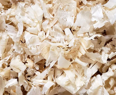Close up of the wood shavings produced by Mala Mills, LLC for premium animal bedding