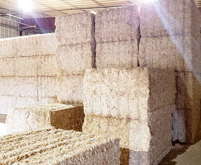 Stacks of XL-Bundles of premium animal bedding produced by Mala Mills, LLC in Little Falls, MN